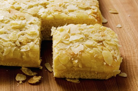 flaked: Bee sting cake with flaked almonds, partly sliced