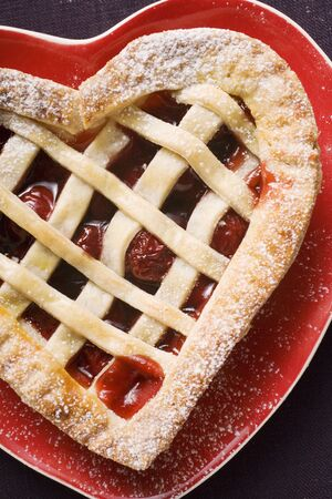 heartshaped: Cherry pie on heart-shaped plate LANG_EVOIMAGES