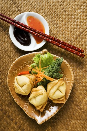 hoisin sauce: Deep-fried wontons with salad and two sauces