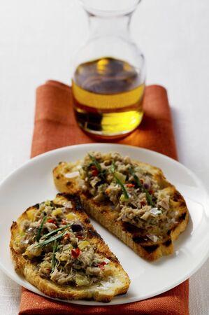 tunafish: Tuna bruschetta on plate, olive oil