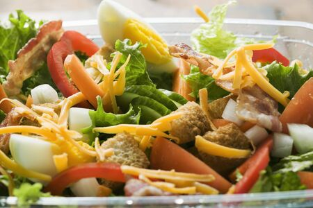 take away: Salad leaves with vegetables, egg, cheese & bacon to take away