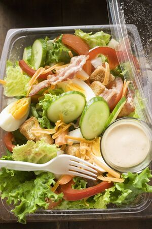 take away: Salad leaves with egg, cheese, bacon and dressing to take away