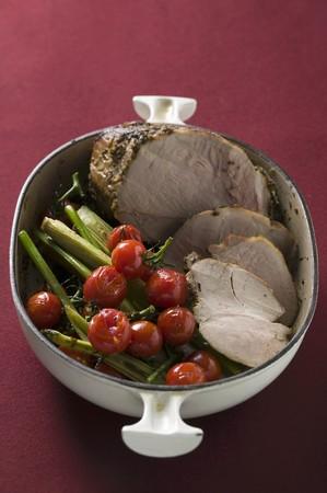 apium graveolens: Roast pork with cherry tomatoes and celery