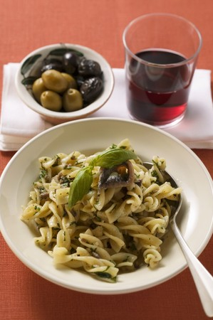 european anchovy: Fusilli with sardines & basil, olives, glass of red wine LANG_EVOIMAGES
