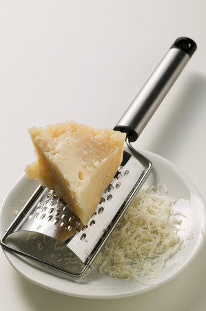 noone: Piece of Pecorino with grater LANG_EVOIMAGES