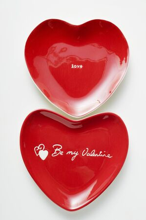 heartshaped: Red heart-shaped plates with the words Be my Valentine & Love LANG_EVOIMAGES