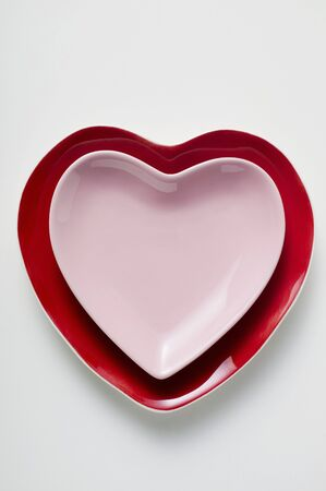 heartshaped: Two heart-shaped plates, one on top of the other