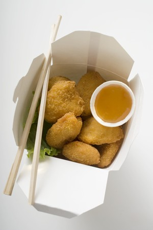 take away: Chicken Nuggets with sweet and sour sauce to take away LANG_EVOIMAGES
