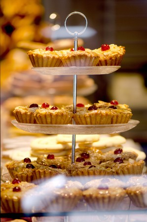 confiserie: Cherry frangipane cakes in the window of a bakery