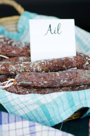 hard sell: French garlic sausage at a market