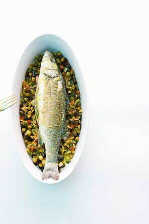 ovenbaked: Oven-baked sea bass with vegetables