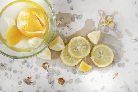 brine: Lemons in brine in a glass bowl and on a stone surface LANG_EVOIMAGES