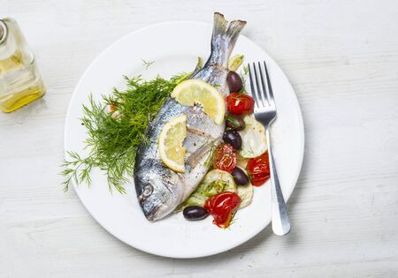 sea bream: Sea bream with tomatoes and olives