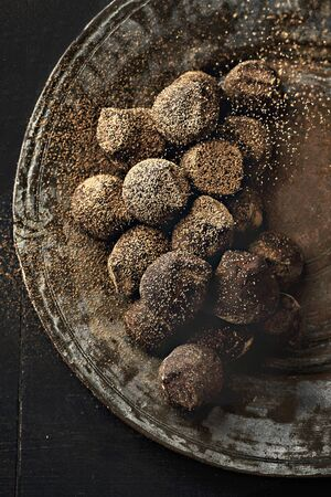 brownness: Chocolate truffles and maple syrup truffles on a plate