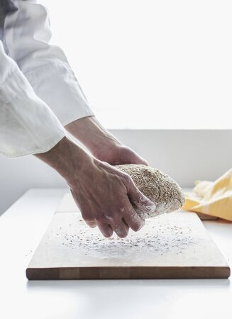 several breads: A backer kneading bread dough