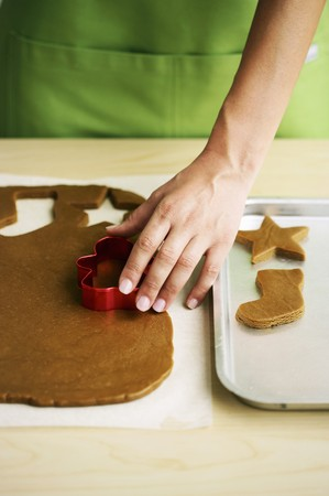 solo  christmas: Christmas biscuits being cut out LANG_EVOIMAGES