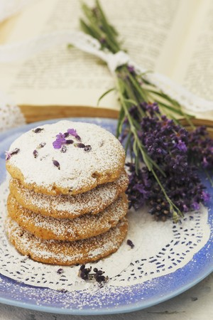 doiley: A stack of lavender biscuits on a plate