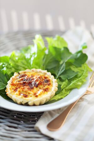 side salad: Chicken tartlet with cheese and a side salad