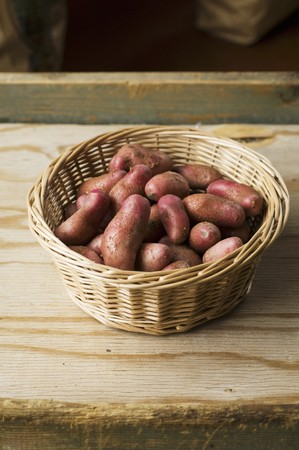 red skinned: A basket of red skinned Cherie potatoes LANG_EVOIMAGES