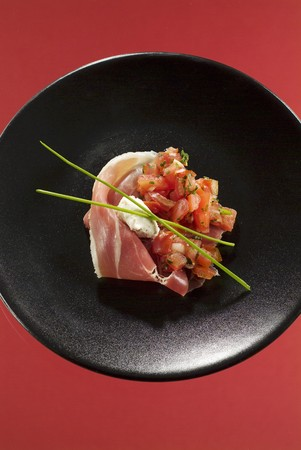 serrano: Serrano ham with diced tomatoes LANG_EVOIMAGES