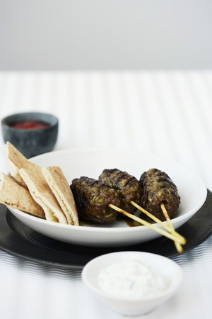 unleavened: Lamb kofta with tzatziki and unleavened bread