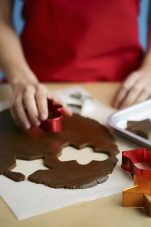 solo  christmas: Gingerbread biscuits being cut out