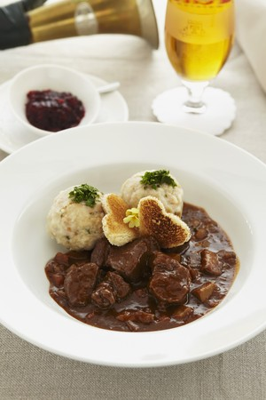 near beer: Young venison ragout with bread dumplings and cranberries