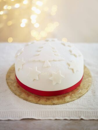 satin ribbon: A festive Christmas cake decorated with a red satin ribbon