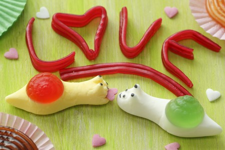 childs birthday party: The word LOVE and fruit gum snails