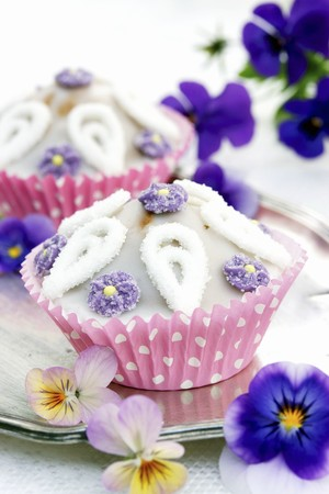silver tray: Cupcakes with sugar flowers and tufted pansies on a silver tray