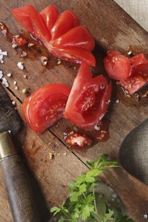 beefsteak: Sliced beefsteak tomatoes on a wooden board