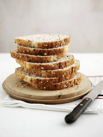 several breads: A loaf of sliced bread with oats and flax seeds LANG_EVOIMAGES