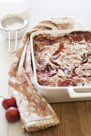plum pudding: Freshly baked clafoutis with plums in a baking dish