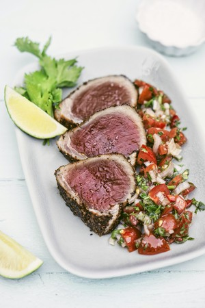 fennel seeds: Tuna fish steaks with a sesame seed crust served with fennel seeds, coriander and a tomato and onion salsa LANG_EVOIMAGES