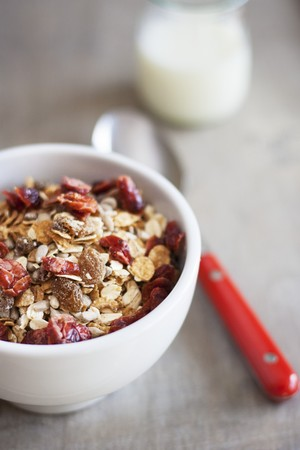 musli: A bowl of muesli and a bottle of milk