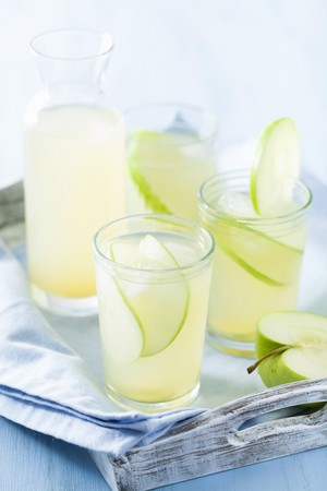 soda pops: Apple and ginger lemonade in glasses and a carafe