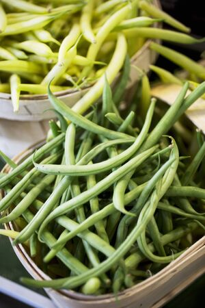 wax sell: Green and yellow beans at a market