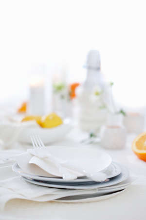 noone: A table laid with white plates and cutlery LANG_EVOIMAGES