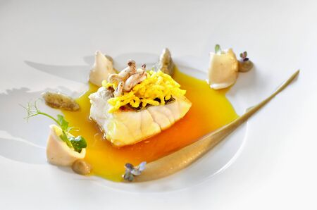 calamares: Sea bass with puffed saffron rice, aubergines and calamaretti LANG_EVOIMAGES