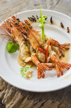 gambas: Whole king prawns with chilli peppers on a plate