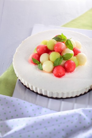 peppermint cream: A cream cheesecake decorated with colourful melon balls and peppermint leaves LANG_EVOIMAGES