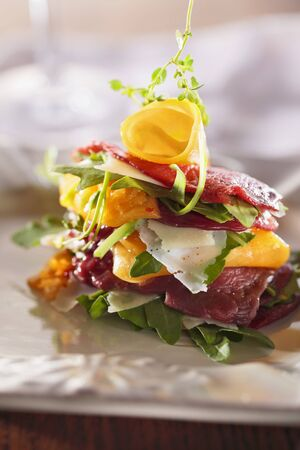 arugola: Beef carpaccio with rocket, yellow peppers and Parmesan