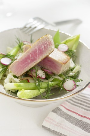 tunafish: Tuna steak on a bed of salad with radishes and dill