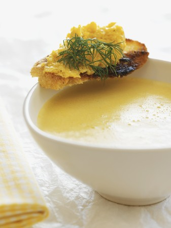 sweetcorn: Cream of sweetcorn soup with a scrambled egg crostino LANG_EVOIMAGES