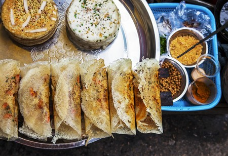dosa: Dosa (fried rice flour crêpes and black lentils) at a street market in Rangoon, Myanmar LANG_EVOIMAGES
