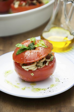 pasta salad: A tomato filled with pasta salad
