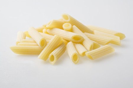 grooved: A pile of fresh Penne Rigate pasta LANG_EVOIMAGES