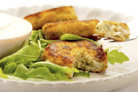 arugola: Fish cakes with rocket and a sour cream dip LANG_EVOIMAGES