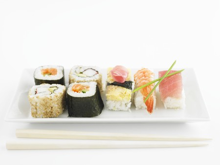 asian pear: Various types of sushi on a rectangular porcelain plate
