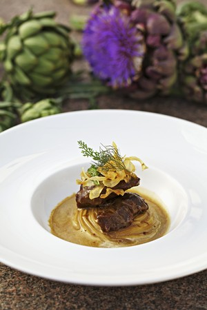 jerusalem artichoke: Braised pork cheeks with artichoke crisps and Jerusalem artichoke cream
